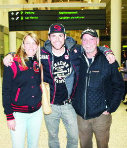 Belfountain snowboarder Jake Holden arrived Monday night at Pearson International Airport, home from the Winter Olympics in Sochi. He was greeted by his mother Renee and father Waldo. Photo by Bill Rea