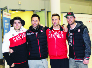Belfountain snowboarder Jake Holden (right) is seen here with teammates Chris Robanske, Robert Fagan and Kevin Hill on their arrival at Pearson International Airport Monday night. Photo by Bill Rea