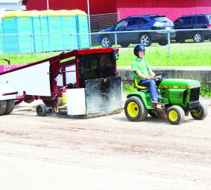 A mini tractor pull was among the attraction at Ribfest. Caledon East area resident Greg Reid drove this John Deere for a 235 feet two inches pull.