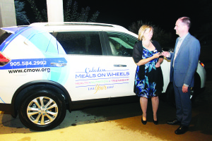 Drew Delaware of Performance Auto Group presented the keys to the 2015 Nissan Rogue to Caledon Meals on Wheels Executive Director Christine Sevigny. Photo by Bill Rea
