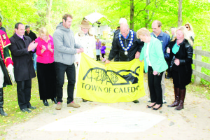 Mayor Allan Thompson was on hand Saturday to help Jake and Beverly Holden unveil their stone on Caledon's Walk of Fame. Also seen here are Councillor Rob Mezzapelli, Dufferin-Caledon MPP Sylvia Jones and Councillors Barb Shaughnessy, Nick deBoer and Jennifer Innis. Photo by Bill Rea