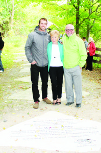 Jake and Beverly Holden stand next to their stone on Caledon's Walk of Fame with Jeff Holden, who nominated them.