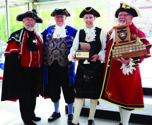 Caledon Town Crier Andrew Welch (second from right) was the overall winner at the Provincial Championships, run by the Ontario Guild of Town Criers. On hand for the award presentation were Crier Brent McLaren (Town Crier of Perth and competition host), Crier Bill McKee and Crier Chris Whyman holding the Guild trophy. Photo by Elswyth Fryer