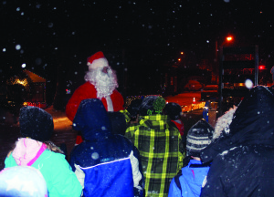 Santa Claus was out too, joining revellers on hay rides through the streets of the village. Photos by Bill Rea