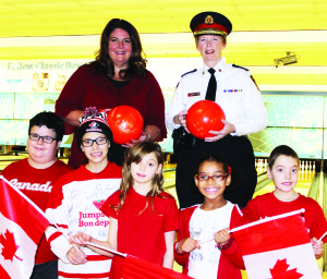 Big Brothers Big Sisters of Peel President and CEO Shari Lynn Ladanchuk is seen here with Peel Regional Police Chief Jennifer Evans, along with Little Brothers and Sisters Patrick, Alyssa, Emily, Adrianna and Cameron.