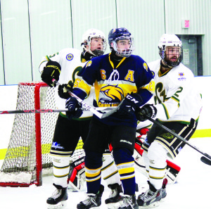 Matt Magliozzi plants himself in front of the Stayner net in a Caledon Golden Hawks game against the Siskins in November. Photo by Jake Courtepatte
