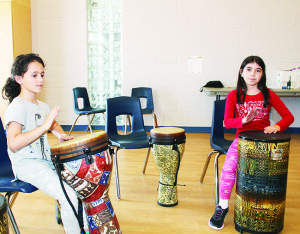 Marisa DeFrancesca, 8, and Melissa Aiello, 9, both of Bolton were having fun practising on the drums at CCRW.