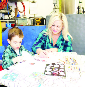 The Wassailing Festival featured a number of crafts for young people to work on. Stephanie Dobbin of Brampton was helping her son Carter, 3, with his.