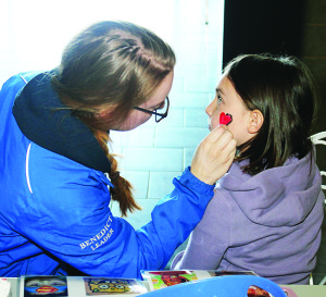 There was the chance for young folks to get their faces painted. Teen Ranch staff member Hannah Benedict was working on a design for Avery Carr, 7, of Georgetown.