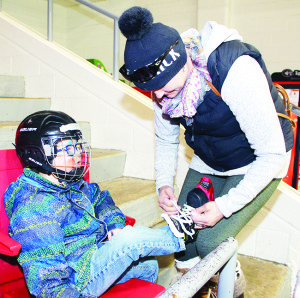 Some of the planned events at Teen Ranch on Highway 10 had to be canceled, but people were able to get in some skating. Orangeville area resident Amanda Davidson was helping tighten the skates for her son Shea, 4.