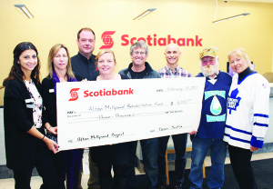 BOOST FOR MILLPOND REHABILITATION The weather might not have been ideal for the recent Alton Millpond Hockey Classic at Alton Mill, but the results were still pretty good. Mill co-owner Jeremy Grant said $10,000 was raised and another $3,000 was contributed by the Scotiabank branch in Orangeville to the Alton Millpond Rehabilitation Project. On hand for the recent cheque presentation were Brittney Ventura, Christine Ciurleo, Dirk Kuemmling and Valerie Borden of Scotiabank, Grant, Randy Ugolini of the Mill Pond Association and event committee members Steve Hayward and Beth Staite. Photo by Bill Rea