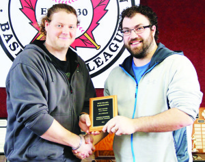 North Dufferin Baseball League Vice-President Tyler Linger presents Bolton's Michael Gemmiti with the award for best batting percentage at the league's annual awards banquet in Lisle Sunday. Photo by David Andersen, NDBL