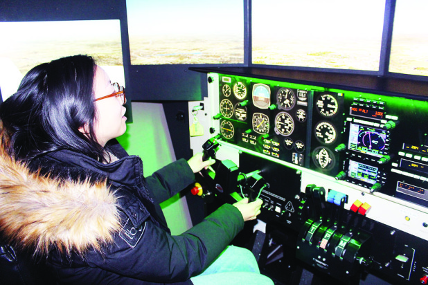 WOMEN LEARN ABOUT FLIGHT AT BFC Last week was Women in Aviation Week, and Brampton Flight Centre marked the occasion by giving women and girls interested in flight the chance to see what it's like. Toronto resident Jenny Yin, who works for a software company that provides equipment for aircraft, was trying her hand at a simulator. Photo by Bill Rea