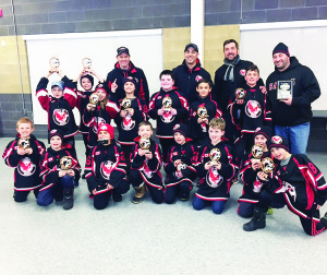 NOVICE HAWKS WIN IN NIAGARA FALLS The Caledon Hawks Novice Rostered Select Team were the 2017 Ange Giajnorio Memorial Winter Thaw Tournament Champions in Niagara Falls. The Hawks won the final game 5-1 against Chedoke Express. All their hard work and determination allowed the Hawks to set the tone early by scoring the first goal in the first shift of each of the five games they played. The Hawks offensively out skated their opponents by putting up 16 goals while defensively shutting them down by only allowing three against. Seen here with their trophies are (back row) John Cheesman (trainer), Russ Sigler (assistant coach), Pino Agostino (head coach), Mark Prieur (assistant coach), (middle) Zenon Lipinski, Bryce Prieur, Ryker Skimming, Luca Lapiccirella, William Pankiw, Evan Sigler, Nevan Cegar, (front) Carter Hay, Kevin Rivait, Matteo Monaco, Braydon Searles, Myles Cheesman, Nicolas Bolognese, Nicolas Corsi and James Agostino.