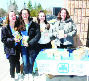 TIME TO BUY GIRL GUIDE COOKIES It that time of year again, when Girls Guides are out selling their delicious cookies. These members of the 1st Caledon East Pathfinders were out in front of the Foodland in Caledon East Saturday selling boxes of cookies to shoppers. Seen here are Crystal Tanton, Mikayla Lorini and Madison and Kelly Brownlee. Photo by Bill Rea