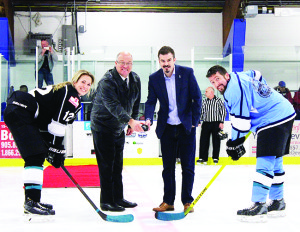 Mayor Allan Thompson and Tyler Puley, co-founder of Tealpower, handled the opening face-off at Saturday's match. The draw was between Rebecca Vint and Steve Conforti. Photo by Jake Courtepatte