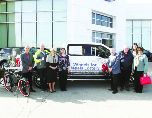 Members of Caledon Meals on Wheels, Caledon councillors, MPP Sylvia Jones and Bob Fines pose next to the grand prize in the new lottery — a Ford F-150 pickup truck.