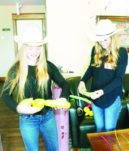 Volunteer Lauren Tutt and Teen Ranch staff member Elly Ensom were creating balloon sculptures.