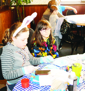 "There were craft activities at Teen Ranch. Cailey Allen, 8, and Lily Dasilva, 10, of Orangeville were working on dying ""dinosaur"" eggs."